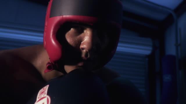 MS Teenage boxer (14-15) punching at camera / Jacksonville, Florida, USA