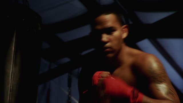 MS Teenage boxer (14-15) punching towards camera / Jacksonville, Florida, USA