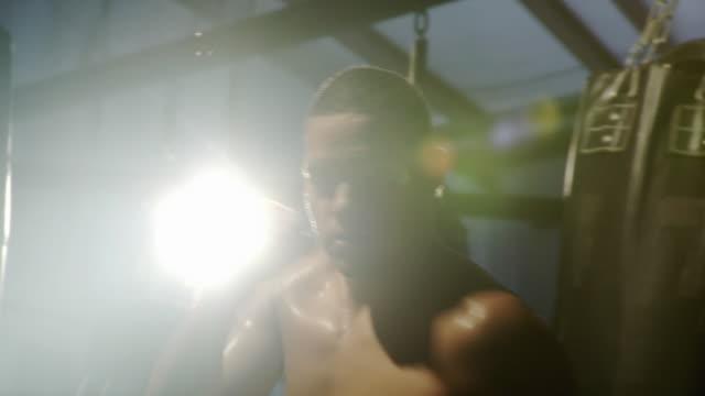 MS Teenage boxer (14-15) punching towards camera, portrait / Jacksonville, Florida, USA