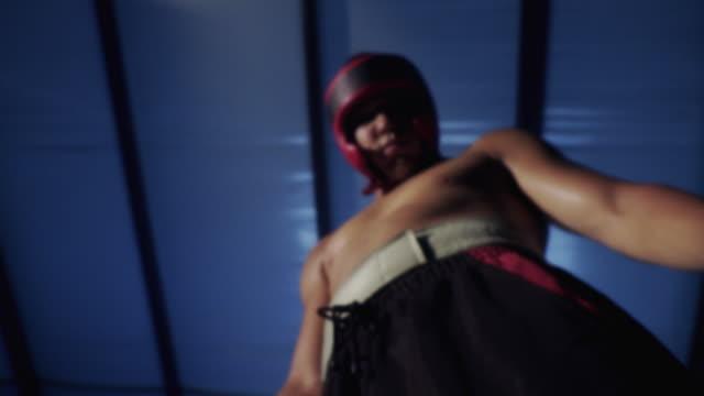 MS Teenage boxer (14-15) wearing safety helmet / Jacksonville, Florida, USA