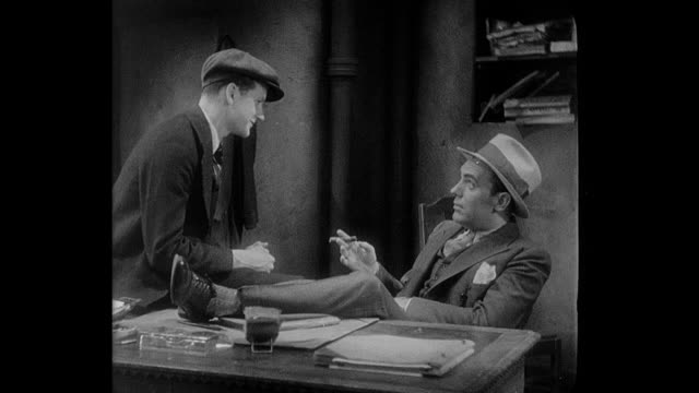 A teenage boy (Junior Durkin) gets a job from a gangster (Pat O'Brien)