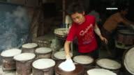 MS PAN Teenage boy making pancakes on street market / Burma