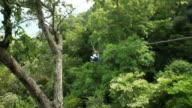 Teenage boy riding a zipline
