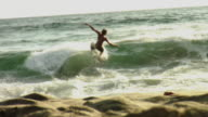 WS Teenage boy (14-15) skim boarding on beach / Laguna Beach, California, USA