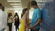 MS Teenage couple (14-17) embracing in school corridor / Spanish Fork City, Utah, USA