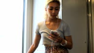 Teenage girl cracks a smile while texting