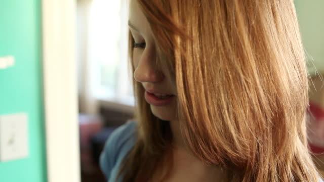Teenage girl eating slice of apple