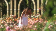 SLO MO WS Teenage girl (16-17) in summer garden, Lehi, Utah, USA