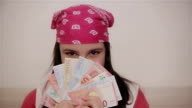 Teenage girl portrait with money