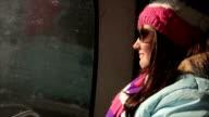 Teenage girl rides on ski lift