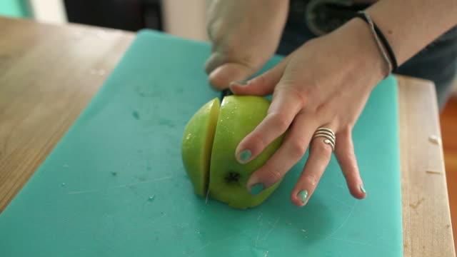 Teenage girl slicing apple