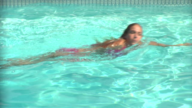 CU, Teenage girl (16-17) swimming in pool, Middlesex, New Jersey, USA