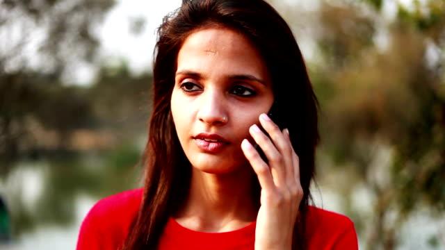 Teenage girl talking on smart phone