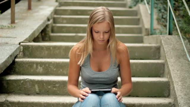 teenage girl using digital tablet