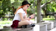 Teenage girl using smartphone in the city
