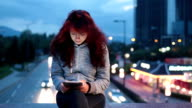 Teenage girl using tablet pc in the city
