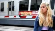 Teenage girl with train going by