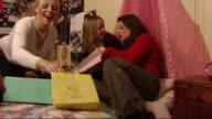 Teenage Girls choosing CD