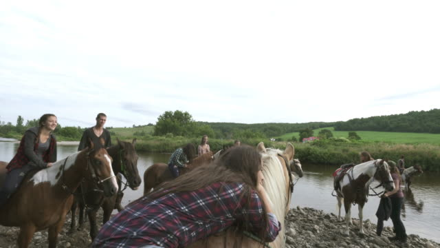 Teenage Girls Group Riding Horses River Nature