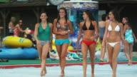 teenage girls walking through a water park