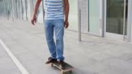 Teenage male skateboarding