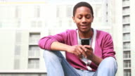 Teenage male texting on mobile phone