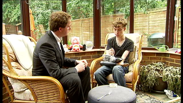 Teenage motor racing fan gets bionic hand from Mercedes team interview and demonstration of hand Matthew James interview SOT On difference between...