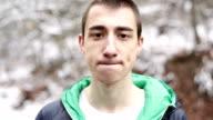 Teenager boy posing and looking at camera