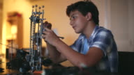 MS Teenager building a science project