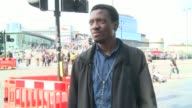 Teenager held after Stratford acid attack DAY Various of people into and out of the Stratford Centre Vox pops SOT Entrance to Stratford Centre
