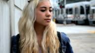 Teenager waiting as subway goes past
