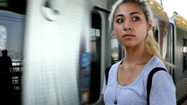 Teenager waiting for train anxiously