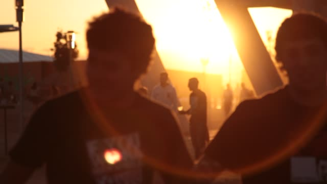 Teenager walking on sunset in Rock In Río Atmosphere Rock In Rio day 1 on June 30 2012 in Arganda del Rey Spain