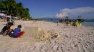 Teenagers Build Sandcastle Near Boracay Rock Boracay Island Philippines NO
