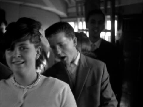 Teenagers dance the jive onboard a train