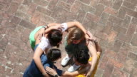 Teenagers embracing together - Cooperation