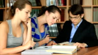 Teenagers learning together indoors in library