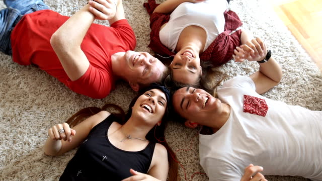 Teenagers lying and laughing at home