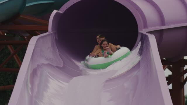 teenagers on a waterslide