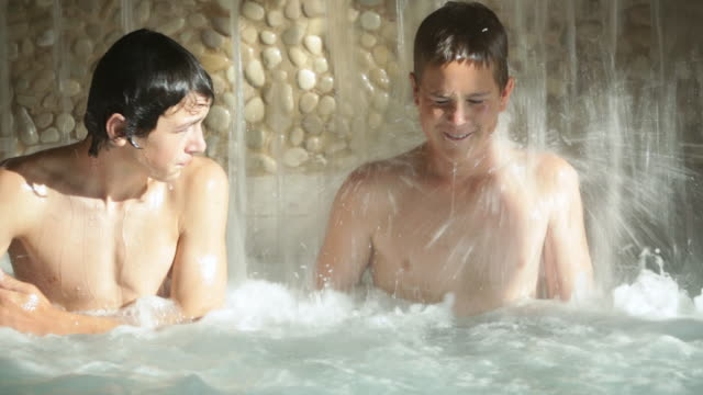 MS Teenagers sitting in a pool waterfall / Stowe, Vermont, United States
