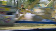 Teens on carnival ride