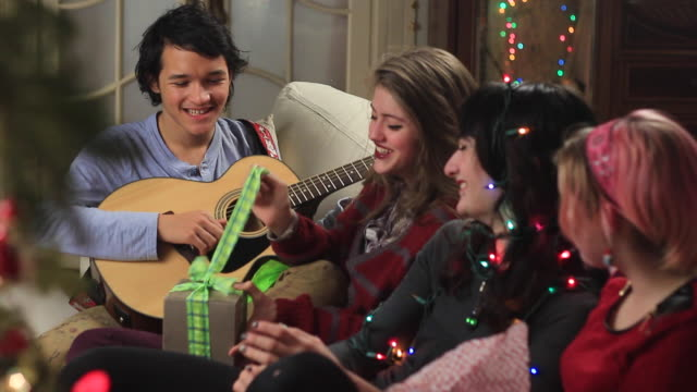 Teens opening Christmas package