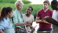 teens with ecology teacher learning environmental conservation on a river