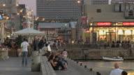 WS Tel Aviv's sea port at sunset with tourists / Tel Aviv, Dan metropolitan, Israel