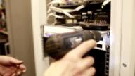 Telecommunication high worker installing data receiver