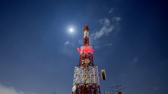 telecommunication Tower Cloudscape at night with star and moon moving