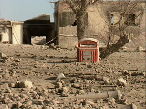 A telephone box partially buried in volcanic ash Plymouth Montserrat 1998