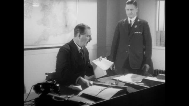 MONTAGE Telephone conversation between diplomats speaking French, with one dispatching assistant and assistant dispatching motorcycle British Army messenger / United Kingdom