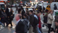 Telephoto shot of People crossing a busy 8th Avenue.
