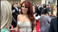 London BAFTA TV Awards EXT **FLASHLIGHT Matt Smith talking to press on red carpet Amy Childs talking to press on red carpet Matt Smith interview SOT...